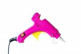 Pink Hot Glue Gun Isolated On A White Background.