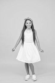 Cute Girly Girl. Happy Girl Yellow Background. Fashion Look Of Small Girl. Little Girl Wear Long Bru