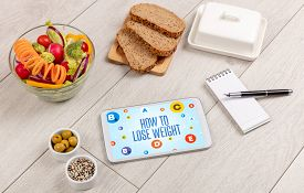 Healthy Tablet Pc compostion with HOW TO LOSE WEIGHT inscription, weight loss concept