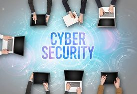 Group of people in front of a laptop with CYBER SECURITY insciption, web security concept