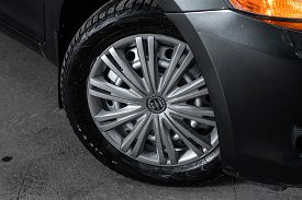 Novosibirsk/ Russia - April 28, 2020: Toyota Yaris , Car Wheel With Alloy Wheel And New Rubber On A