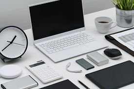 Flat Lay Of Office Desktop And Gadgets At An Angle