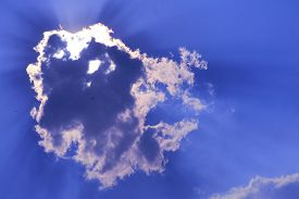 Sun Babk On Cloud And Sunlight Shining And Pass On Purple Blue Sky