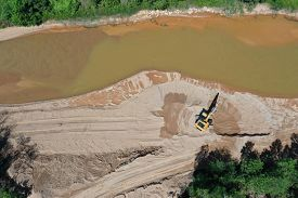 Construction project beside river, causing water pollution and environmental damage