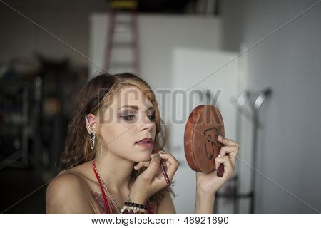 Young Woman Doing Her Makeup