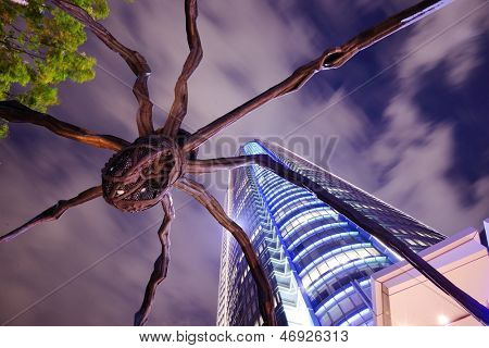 TOKYO - OCTOBER 6: The Spider statue at Roppongi Hills October 6, 2012 in Tokyo, JP. Roppongi hills is a 27 acre mega-complex with the 54-story Mori Tower as the centerpiece.