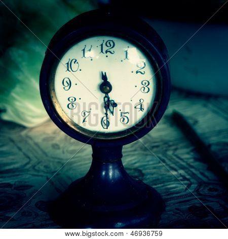 Vintage clock on a table