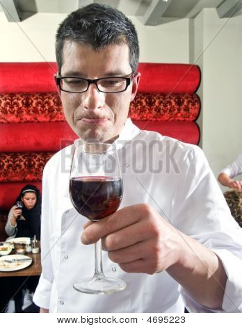 Wine Waiter Savouring Wine