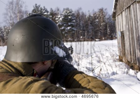 Soviet-finnish War 1939-1940: Red Army Soldier Aims From A Rifle. A Kind From A Back, Focus On A Sig
