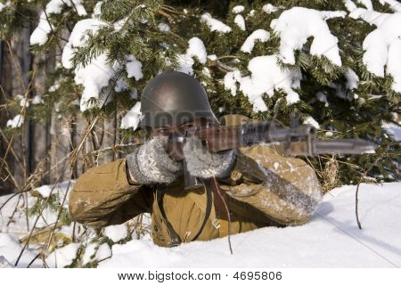 Soviet-finnish War 1939-1940: Red Army Soldier Aims From A Rifle. Focus On The Face