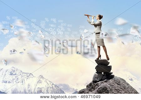 poster of Image of businesswoman looking in telescope standing atop of rock