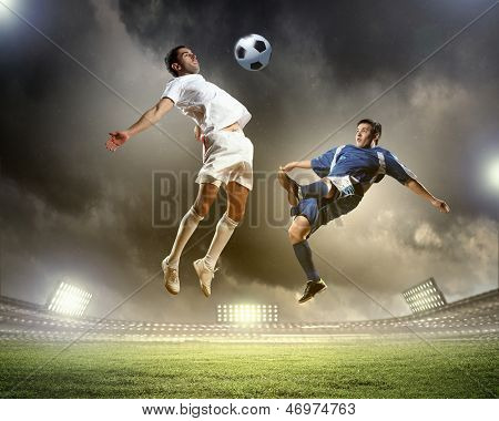 Image of two football players at stadium
