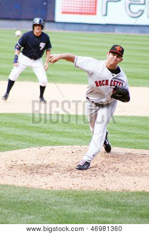 Rochester Red Wings pitcher Carlos Gutierrez fires a pitch