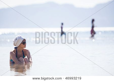 Woman In Water Trying To Cool Down