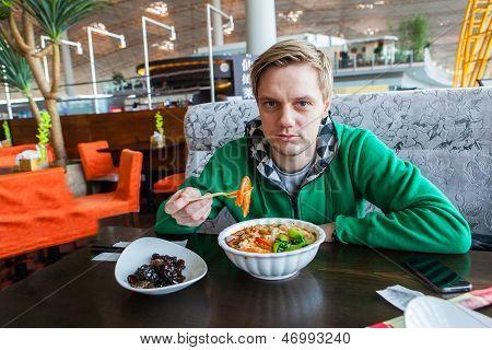 Man Enjoying Shrimp