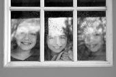 three sister friends looking through the window with a pup and raindrops poster
