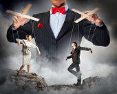 Image of young businessman puppeteer. Leadership concept poster