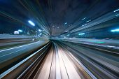 Motion blur of a city and tunnel from inside a moving monorail in Tokyo. poster