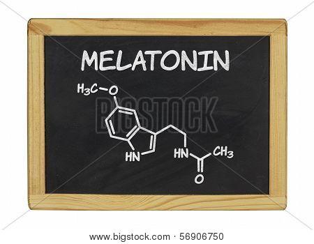 chemical formula of melatonin on a blackboard