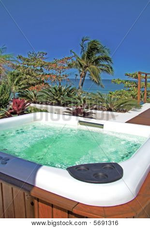 Modern Spa Jacuzzi Outdoors Under Beautiful Blue Sky