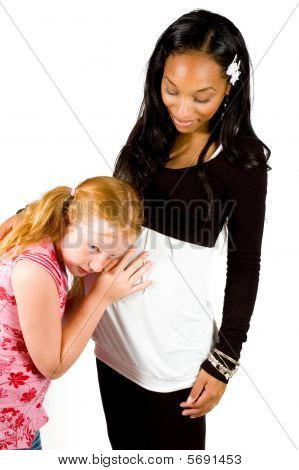 Little Girl Is Listening To The Baby In Her Aunties Belly