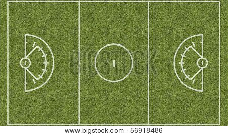 An overhead view of a womens lacrosse playing field with white markings painted on grass. poster