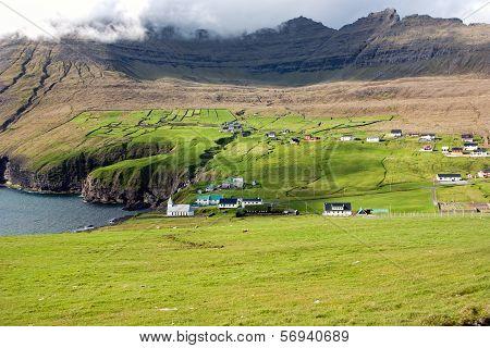 Faroe Islands, Village In A Green Valley Overlooking The Sea