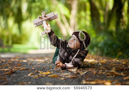 Boy in a park with a plane