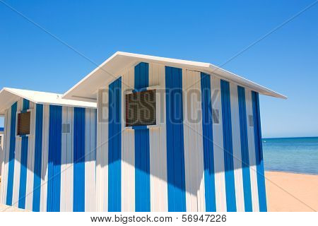 Beach houses in Alicante Denia blue and white stripes at Mediterranean sea of Spain