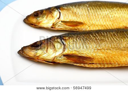 Two Kippers, Smoked Herring On White Plate