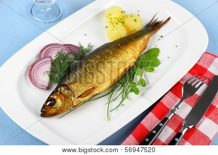Kippers, Smoked Herring On A White Plate With Garnish