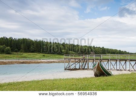 A Quay And A Boat In Northern Norway During Lowtide