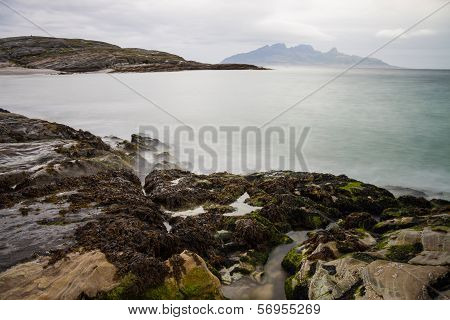 Long Exposure Shot Of Rocks And Waves In Northern Norway