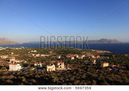 The view across Souda Bay to Akrotiri on Crete shortly after sunrise. The new houses are almost all owned by foreign sunseekers from northern Europe most of them from Britain. poster