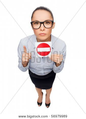 business, protest and office concept - concerned businesswoman in eyeglasses showing stop sign with finger up poster