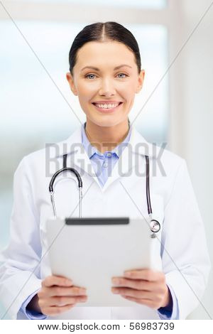 healthcare, technology and medicine concept - smiling young doctor with tablet pc computer and sthethoscope in cabinet