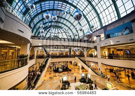 DUBAI, UAE - DECEMBER 19: Shoppers at Mall of the Emirates on December 19, 2013 in Dubai. Mall of the Emirates is a shopping mall before christmas in the Al Barsha district of Dubai.