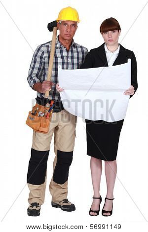 Tradesman and engineer working together