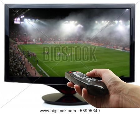 Tv screen with football match and hand with remote control