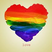 the word love and a rainbow heart painted on a beige background, with a retro effect poster