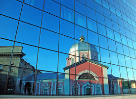 Reflection of old Russian church in the glass wall