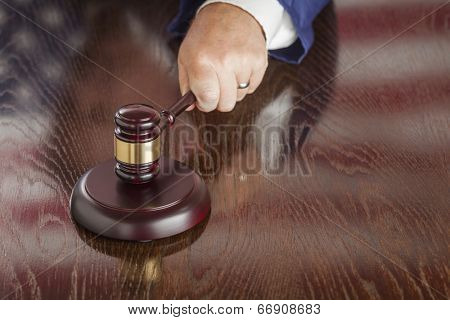 Judge Slams His Gavel and American Flag Table Reflection.