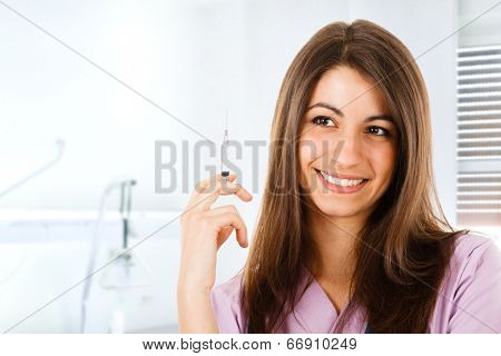 Portrait of a nurse holding a syringe