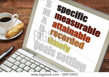 goal setting concept  - SMART (specific, measurable, attainable recorded, timely) -  on a laptop  computer with  espresso coffee