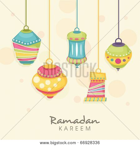 Colorful hanging lanterns on abstract background for holy month of Muslim community Ramadan Kareem.