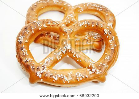 Two Soft Baked Pretzels Isolated Over A White Background