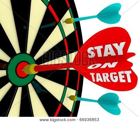 Stay on Target words on a dart board to illustrate keeping your focus on the mission