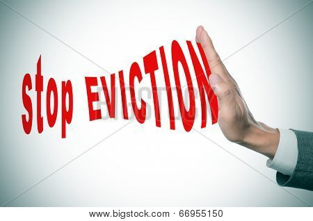 man hand stopping the text stop eviction