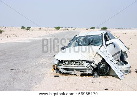 The wreckage of a car in the desert of central Qatar in 2003, apparently the result of a driver losing control at high speed