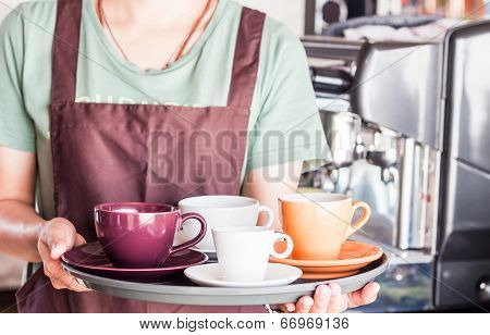Barista Preparing Set Of Freshly Brewed Coffee For Serving
